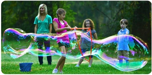 Girl Blowing BIG Bubbles